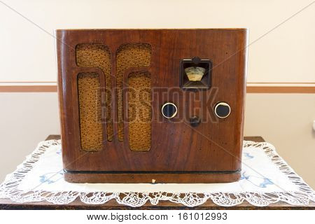 brown wooden retro radio on the table