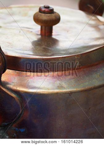 Ancient copper teapot (detail), old-fashioned copper teapot
