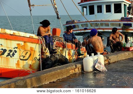 Hua Hin Thailand - December 31 2009: Thai fishermen relaxing on their boat docked at the Hua Hin public fishing pier following a day spent at sea (S)