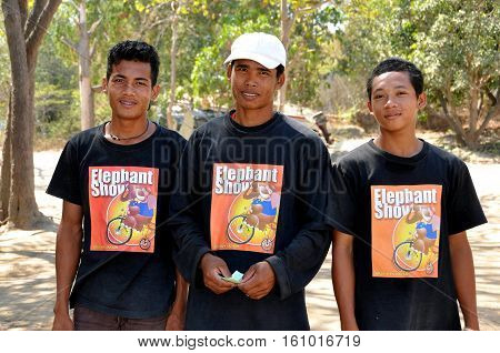 Hua Hin Thaland - January 2 2010: Thai trainers at the Hua Hin Elephant Village wearing tee-shirts with the Elephant Show logo