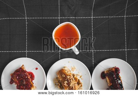 Hot tea with lemon and slices of pie