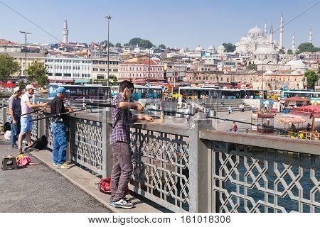Fishermen Are On Galata Bridge In Istanbul
