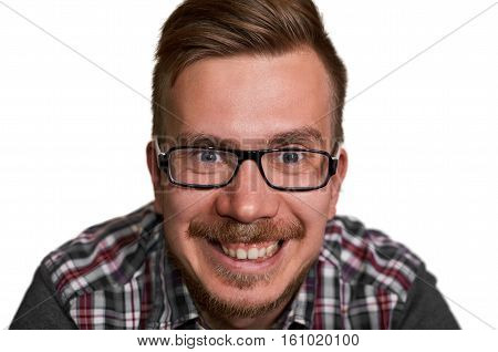 Close up portrait of smiling face with wide open eyes and mouth. Eropean stylish man in glasses and shirt. Crazy engineer look to the camera.