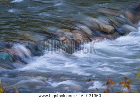Refreshing River Flowing Over Rocks