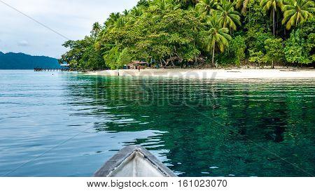 Boat approaching local Village on Friwen Island, West Papuan, Raja Ampat. Indonesia