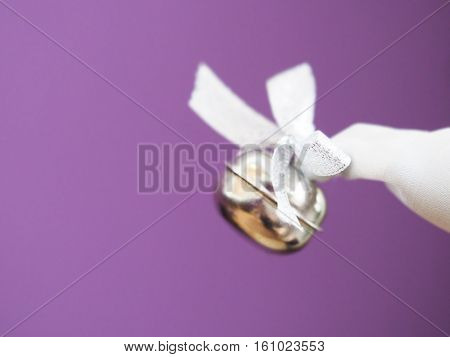 Silver christmas bell on a purple background xmas cap