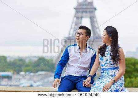 Young Romantic Asian Couple In Paris, France