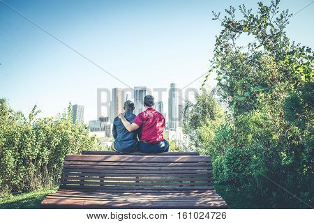 Homosexual couple at a romantic date outdoors - Gay couple in love flirting and having fun