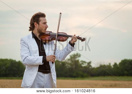 Professional violinist playing violin close up horizontal
