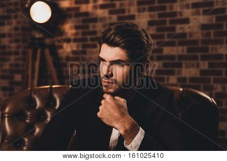Portrait Of Ponder Businessman In Suit Thinking About Future