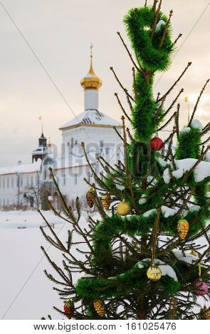 Christmas tree on the background of the church in the monastery