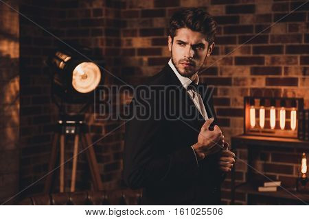 Brutal Hansome Businessman Touching His Black Suit
