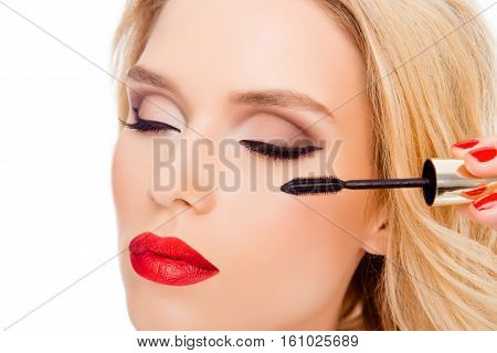 Close Up Of Luxury Woman With Red Lips Doing Make Up With Brush Of Mascara