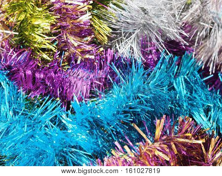 Multicolored shiny Christmas garland festive tinsel background