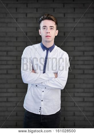 Handsome Young Man Portrait Over Dark Wall Background