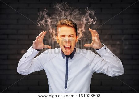 Angry man screaming with smoke coming out of his ears