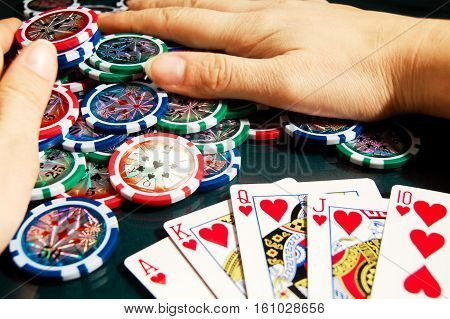 Royal Flash Win In Poker And Female Hands Grabbing Bank