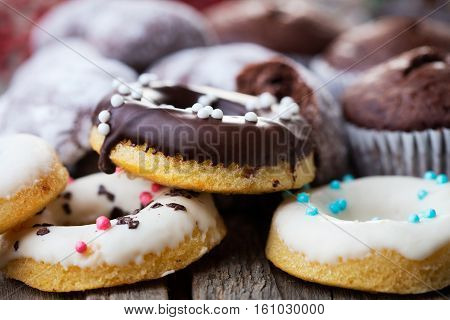 heap of various pastry on wooden background