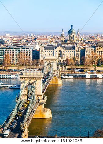 Famous Chain Bridge over Danube River, Gresham Palace and Saint Stephen's Basilica view from Buda Castle on sunny autumn day in Budapest, capital city of Hungary, Europe. UNESCO World Heritage Site