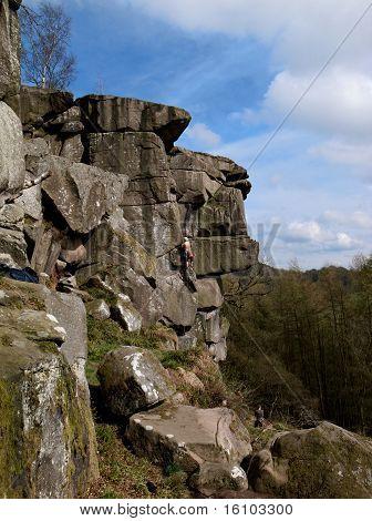 man climbing in rocky landscape