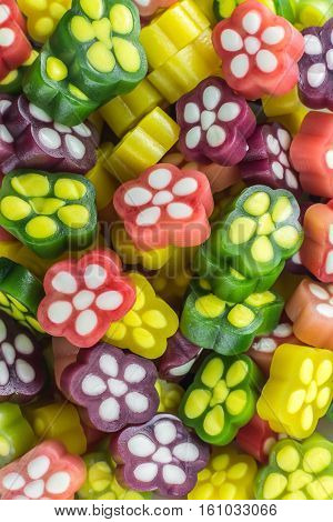 a lot of fruit sugar colorful gummy flowers confectionery
