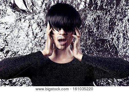 Modern eccentric woman portrait glitter metallic background