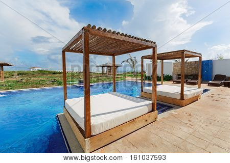 Cayo Guillermo island, Iberostar Playa Pilar hotel, Cuba, June 28, 2016, gorgeous beautiful amazing view of spa with comfortable beds, swimming pool and relaxing atmosphere