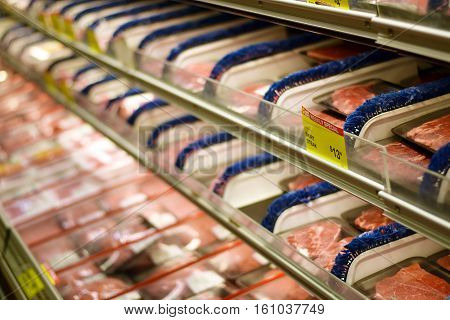 Plastic Wrapped Beef And Pork Products In A Grocery Store