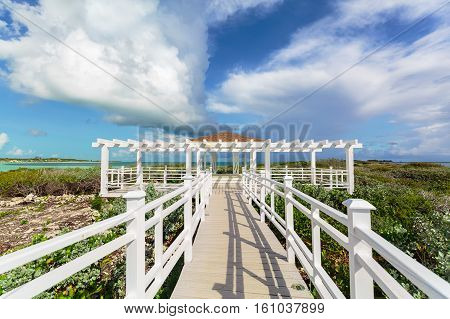 Amazing beautiful view of a gazebo path leading toward the beach and ocean on Cuban Cayo Guillermo Island