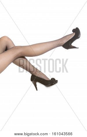 Part body of woman. Slim attractive gorgeous female legs in black pantyhose tights and high heels shoes isolated on white.