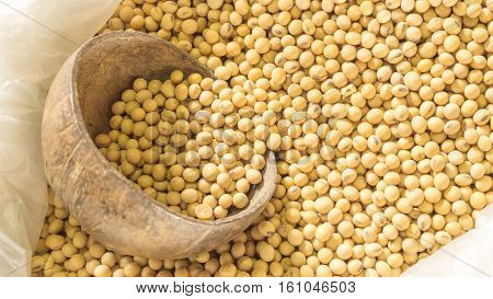 Soybean and organic food concept - Close up soybean with coconut sheel cup in soybean plastic bag. Use for organic food artwork