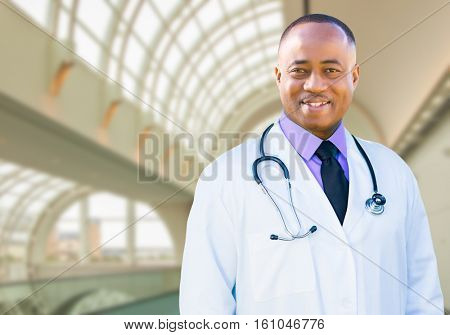Handsome African American Male Doctor Inside Hospital Office.