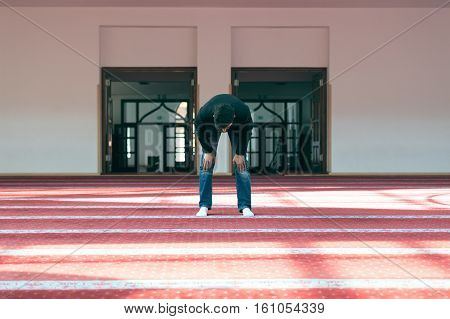 Young beautiful Muslim Man Praying In Mosque.