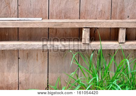 a wood board and a grass background