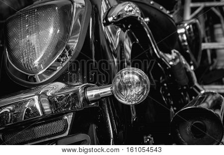 Old and dirty motorcycle tail lights (tail lamp or rear lights) with selective focus and black and white effect