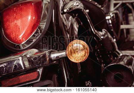 Old and dirty motorcycle tail lights (tail lamp or rear lights) with selective focus and vintage effect