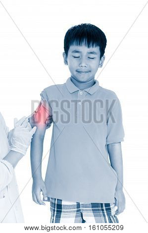 Doctor vaccinating boy's arm. Asian illness boy worry about vaccine syringe. Isolated on white background.  Human health care and medical concept. Photo with color increase blue skin and red spot.