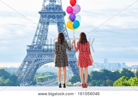 Twins With Colorful Balloons In Paris