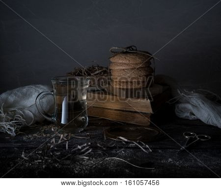 vintage. old books, cup, cakes drapery on a wooden table