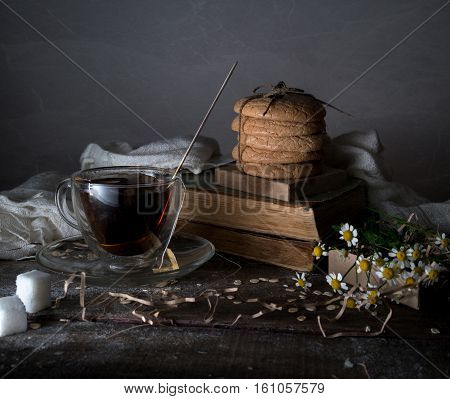 vintage. old books, cup of coffee, pastries, drapery on a wooden table