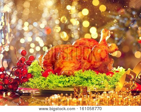 Christmas table setting with turkey. Christmas dinner. Holiday decorated table, Christmas tree, champagne and roasted turkey, New Year served table.