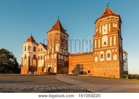 Mir, Belarus - August 24,2016:  Medieval castle in the Belarusian town of Mir on the background of blue sky