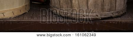 Close up of the bottoms of two wooden vegetable baskets on a metal/wood shelf at the outdoor/indoor Jean-Talon Market in Montreal, Quebec, on a bright day in September.