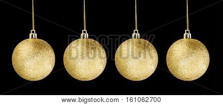 4 Gold glitter ball hanging isolated on dark black background object for holiday happy new year merry christmas