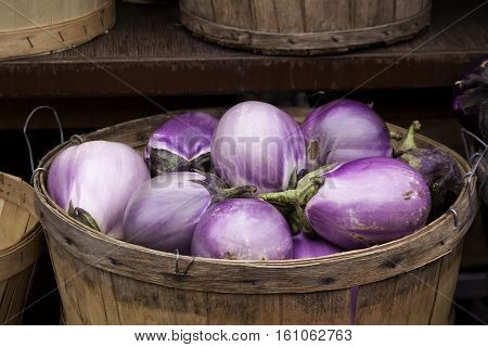 Close up of a basket of purple/mauve onions at the outdoor/indoor Jean-Talon Market in Montreal, Quebec, on a bright day in September.