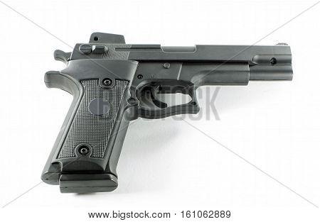 a black handgun on a white background