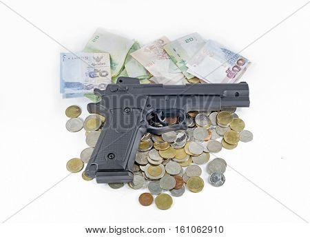 handgun on thai money banknotes and coins