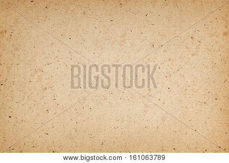 Rough paper background with grained texture and vignette effect
