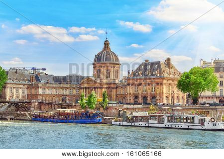 Mazarin Library (bibliotheque Mazarine) And  Bridge Of The Arts ( Pont Des Arts) In Paris. France.
