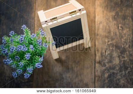 Black Board And Violet Flower On Weeden Background